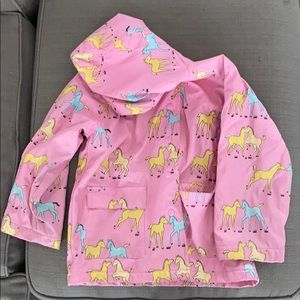 Pink raincoat with horses